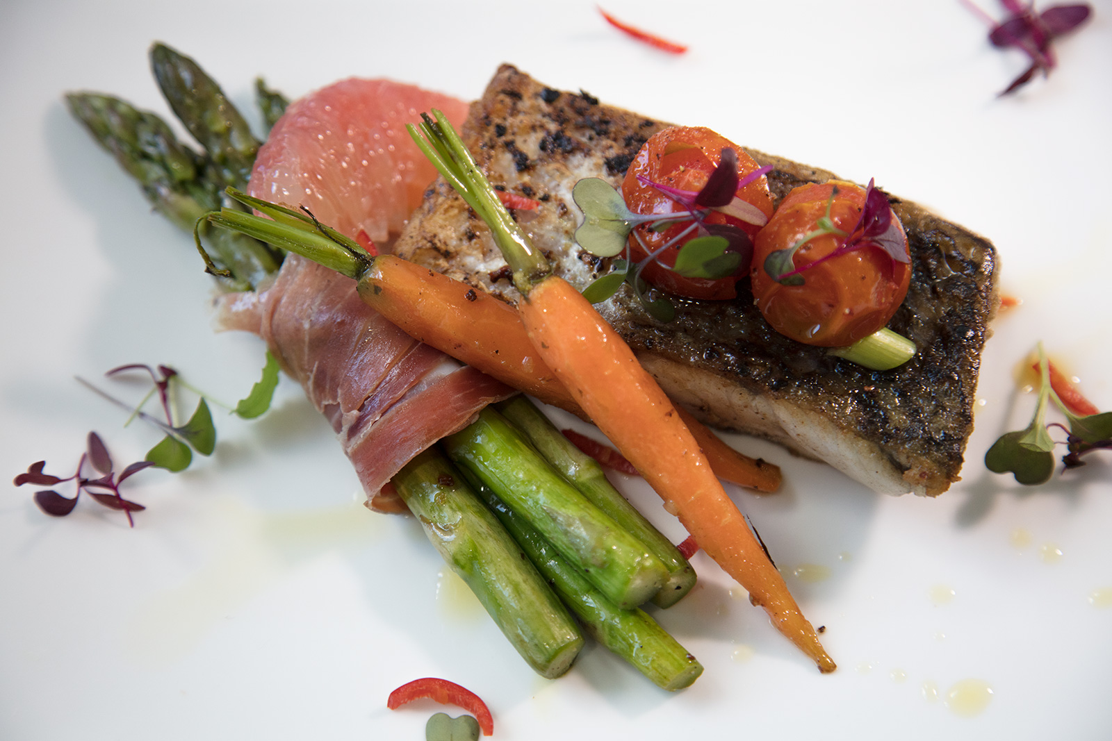 Barramundi on wrapped vegetables